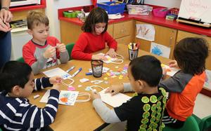 Photo of a group of kindergartners at Lincoln School enjoying Valentine's Day activities.