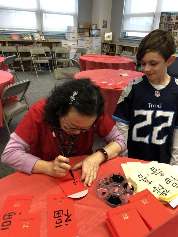Ms. Chiang making Chinese letters on Paper