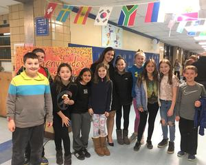 Wilson School 5th graders join elementary Spanish teacher Lisa DeSousa  at Café Cultural on March 28.