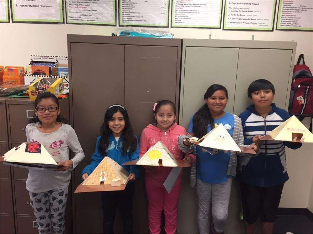 Students with pyramid projects
