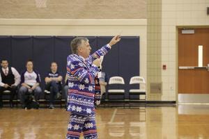 Mr. Noyes leading the teacher auction.