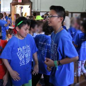Two McKinley students dance at annual McKinley-THON to raise money for pediatric cancer research.