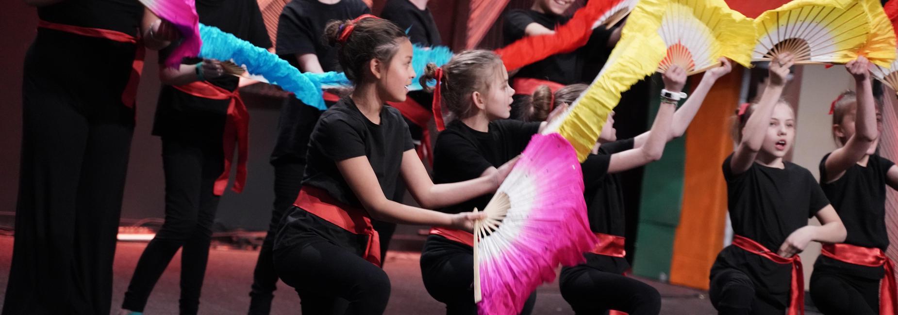 Students fan dancing