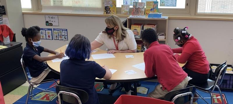 Mrs. Harry teaching students
