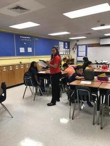 Teacher at student's desks.