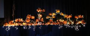 A spooky yet fun pumpkin display in the darkened gymnasium at McKinley School.