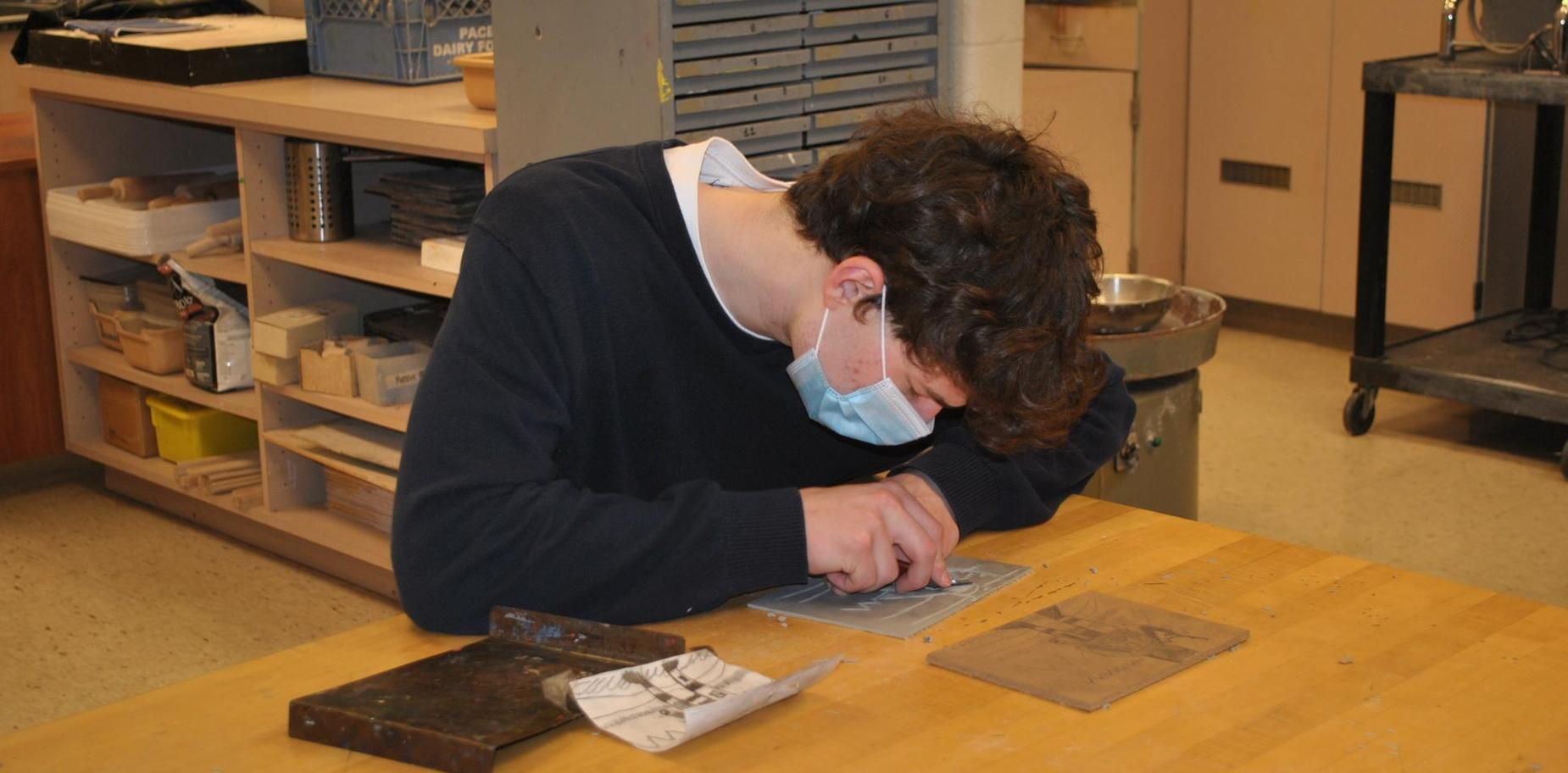 boy etching in art class
