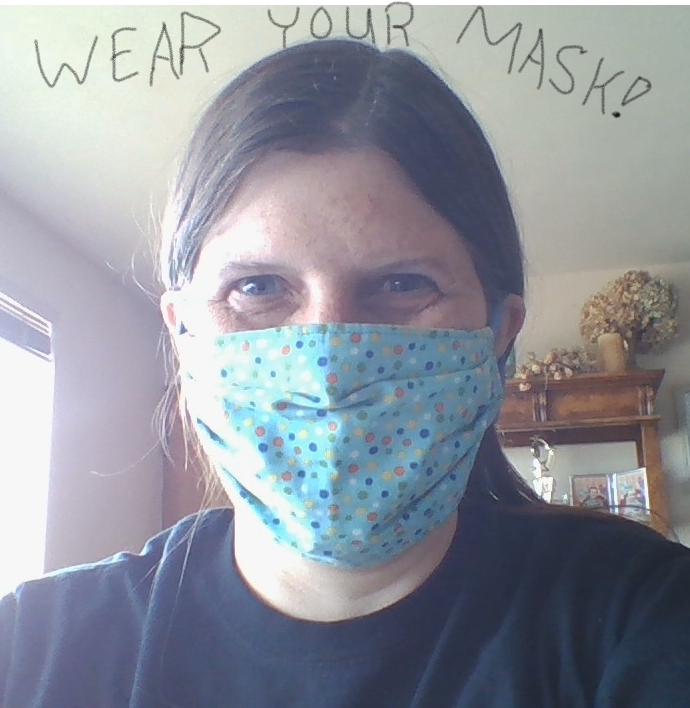 high school teacher wearing mask posing for picture