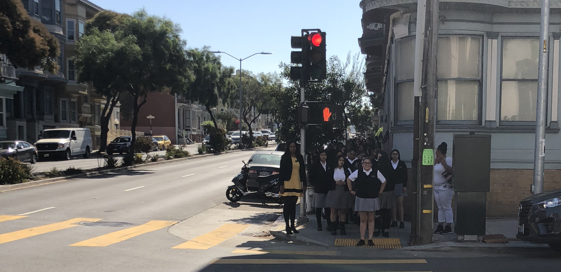 students getting ready to cross the street at intersection