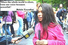 """When the whole world is silent, even one voice becomes powerful."" -Malala Yousafzai Malala,  Image of student of student taking to news crew."