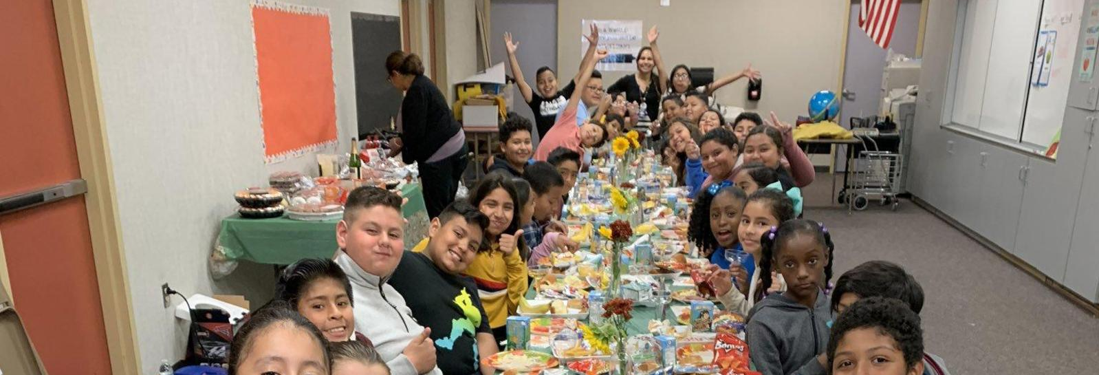 5th grade teacher Mrs. Caganap and her class enjoy a special Thanksgiving feast together!