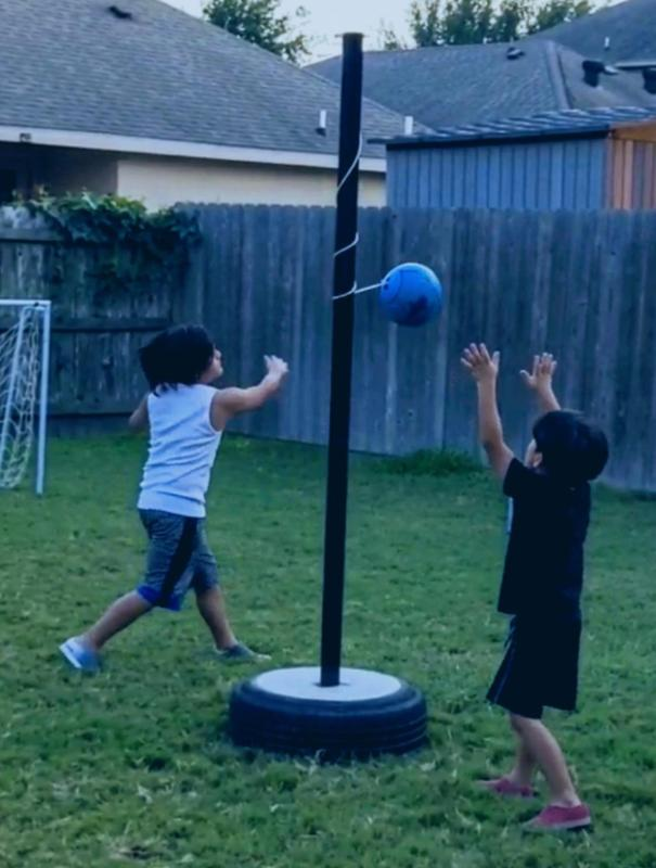 brothers playing tether ball
