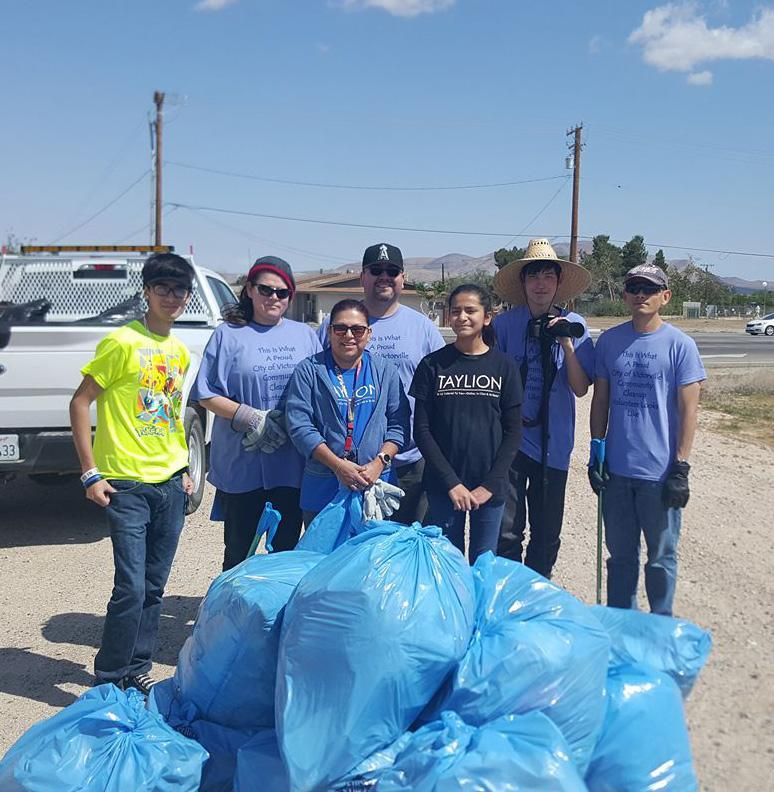 Nolan and students at local community clean up