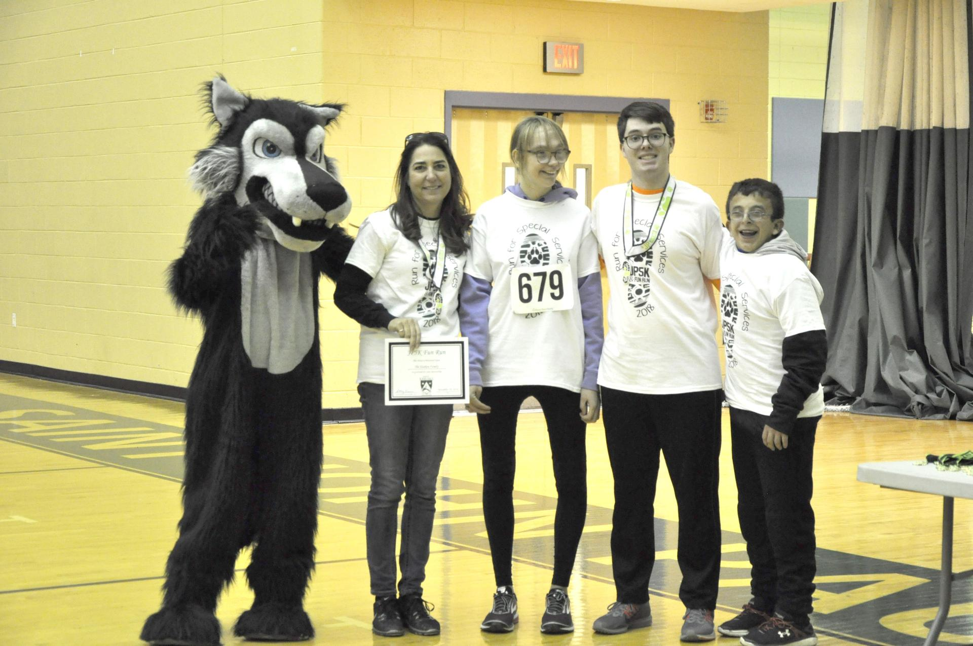 A group of students and the school mascot