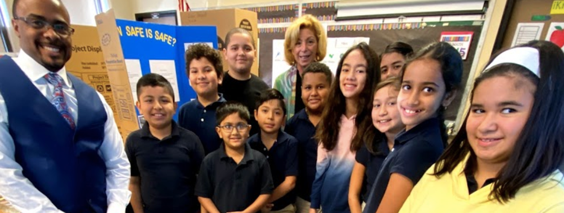 2019 Charles E. Trefurt Elementary School Science Fair Participants stand with projects accompanied by Principal Maris Migliozzi and Vice Principal Darrell Carson