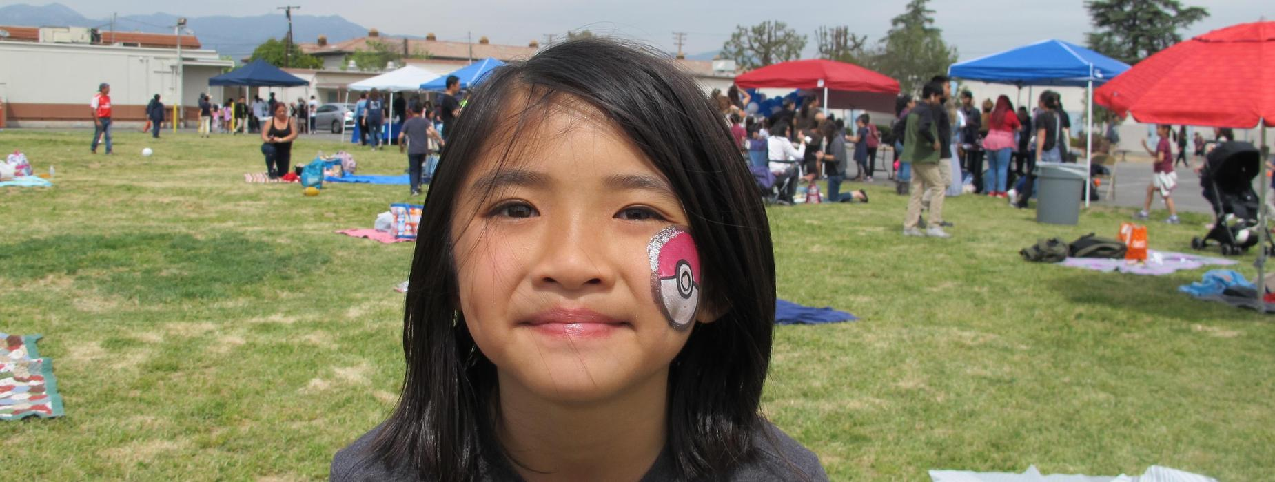 Marguerita Student gets a poke ball face painting