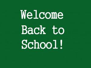 Welcome back to school written in white with a green background