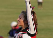 MWJH cheerleader cheering at a football game