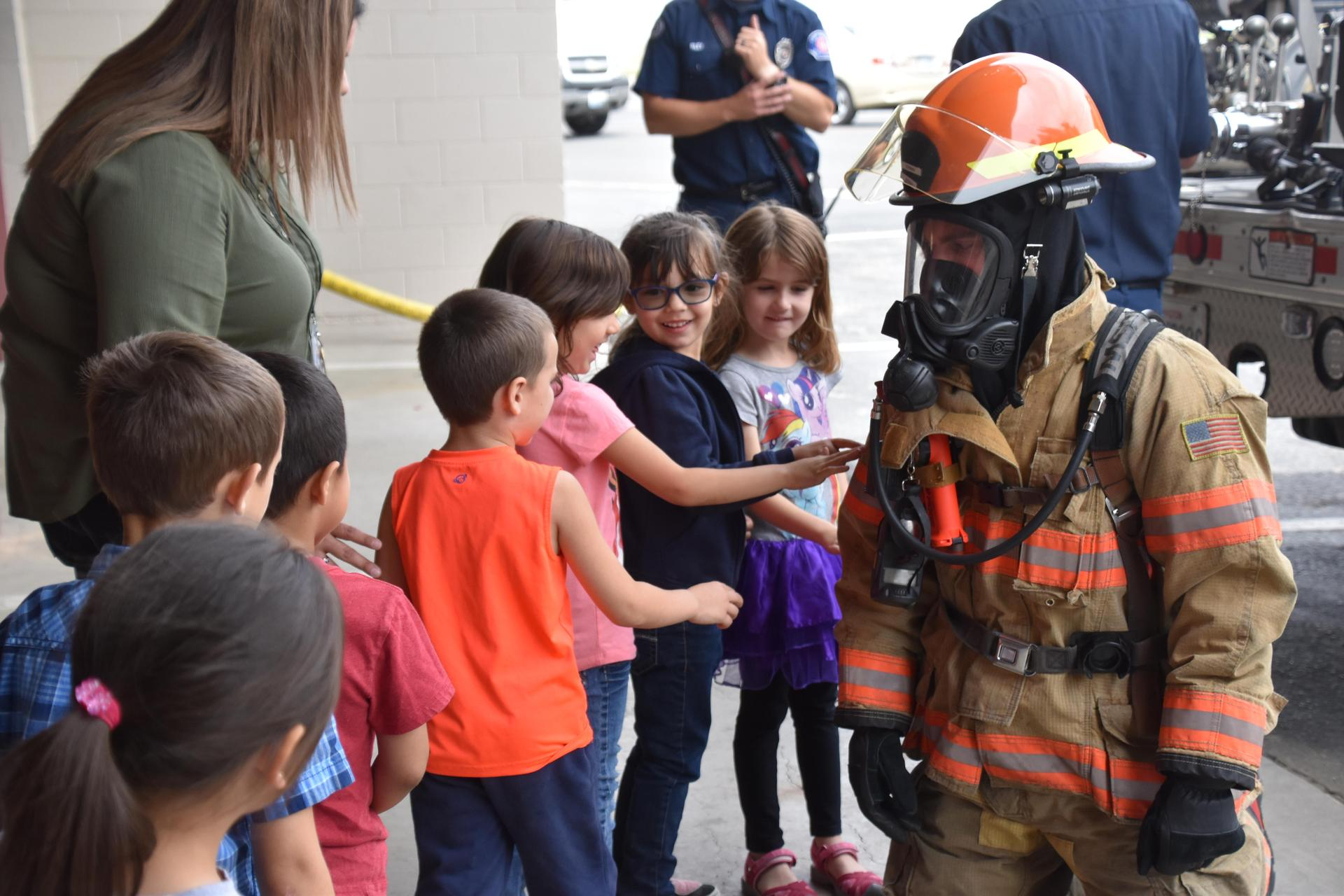 Kids getting to check out the firefighter special gear.