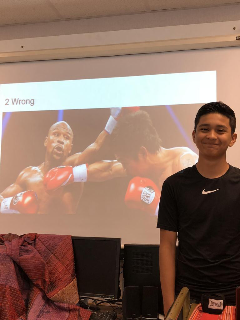 Student presenting on boxing
