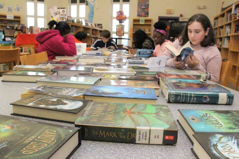 Students in Mr. Harris's sixth grade class participate in a Book Tasting on Thursday, January 17th.