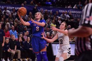 Addison Wedin drives for the basket