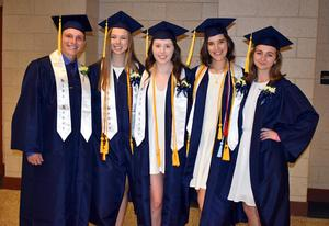 Five High School graduates pose for a photo.