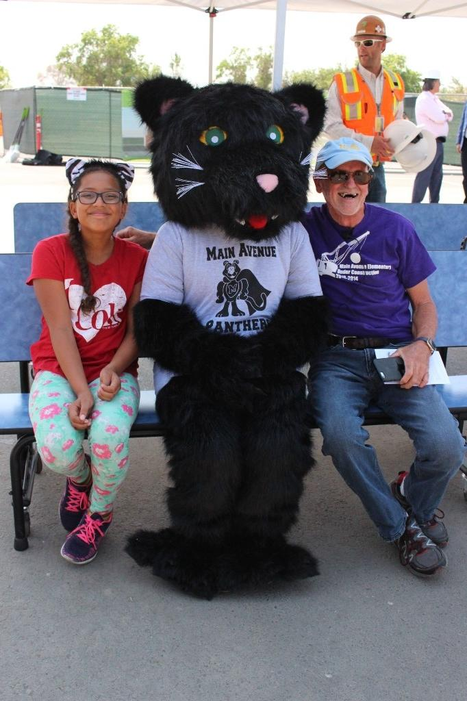 Board of Trustee President Dennis Boyd with Main Avenue Mascot