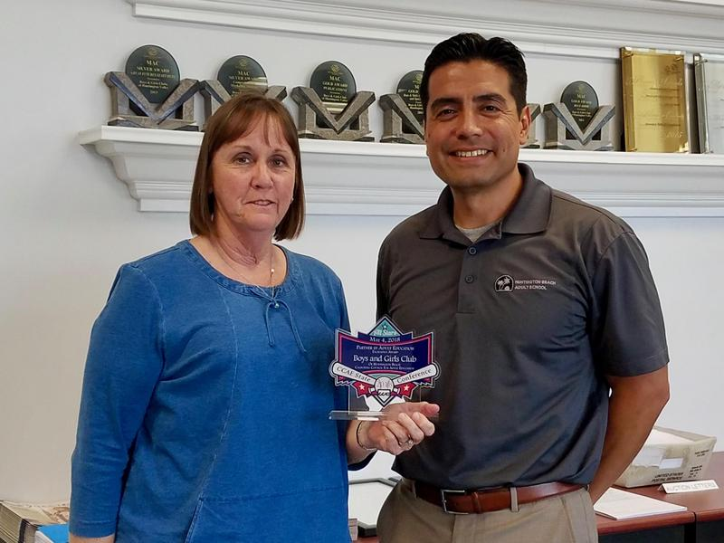 Principal Curiel presents award to Boys and Girls Clubs of Huntington Valley