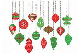 15 red and green small ornaments hanging from long strings on white background