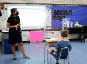 Extended School Year teacher Alyssa Young reinforces reading skills during an ESY elementary class.