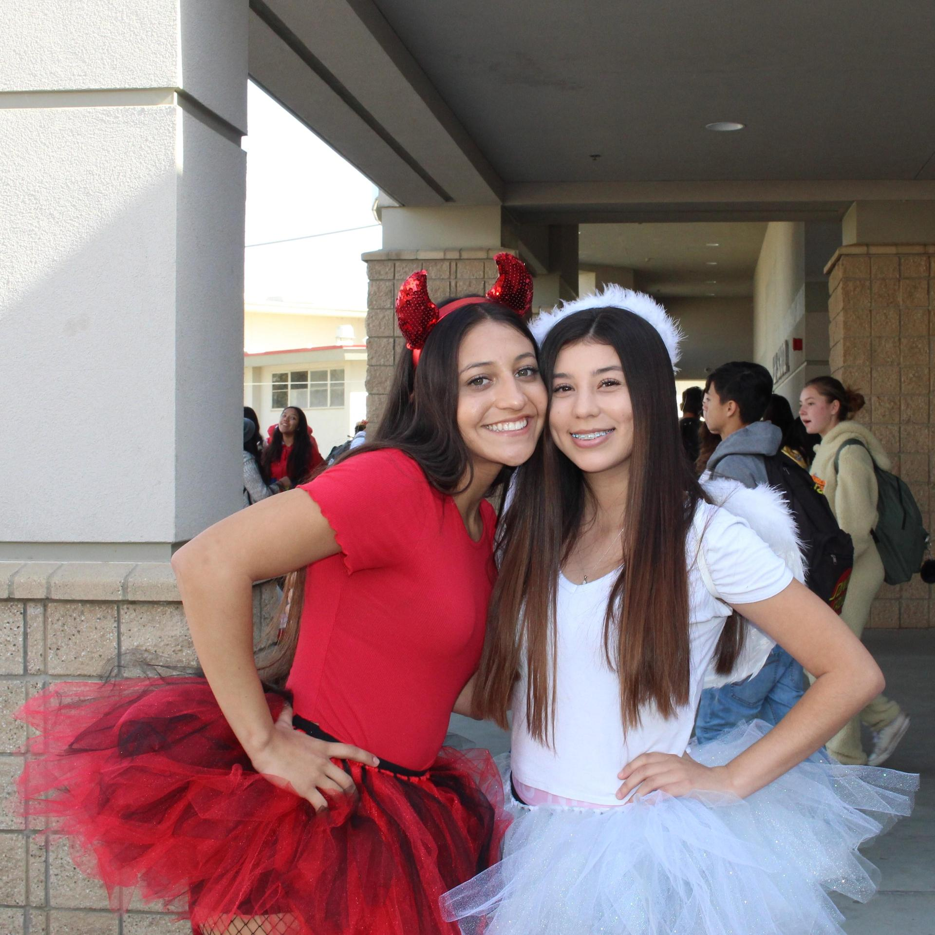 Bella Martinez dressed as the devil and Alyzbeth Escobar dressed as an angel