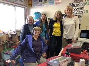 retired teachers helping at book fair