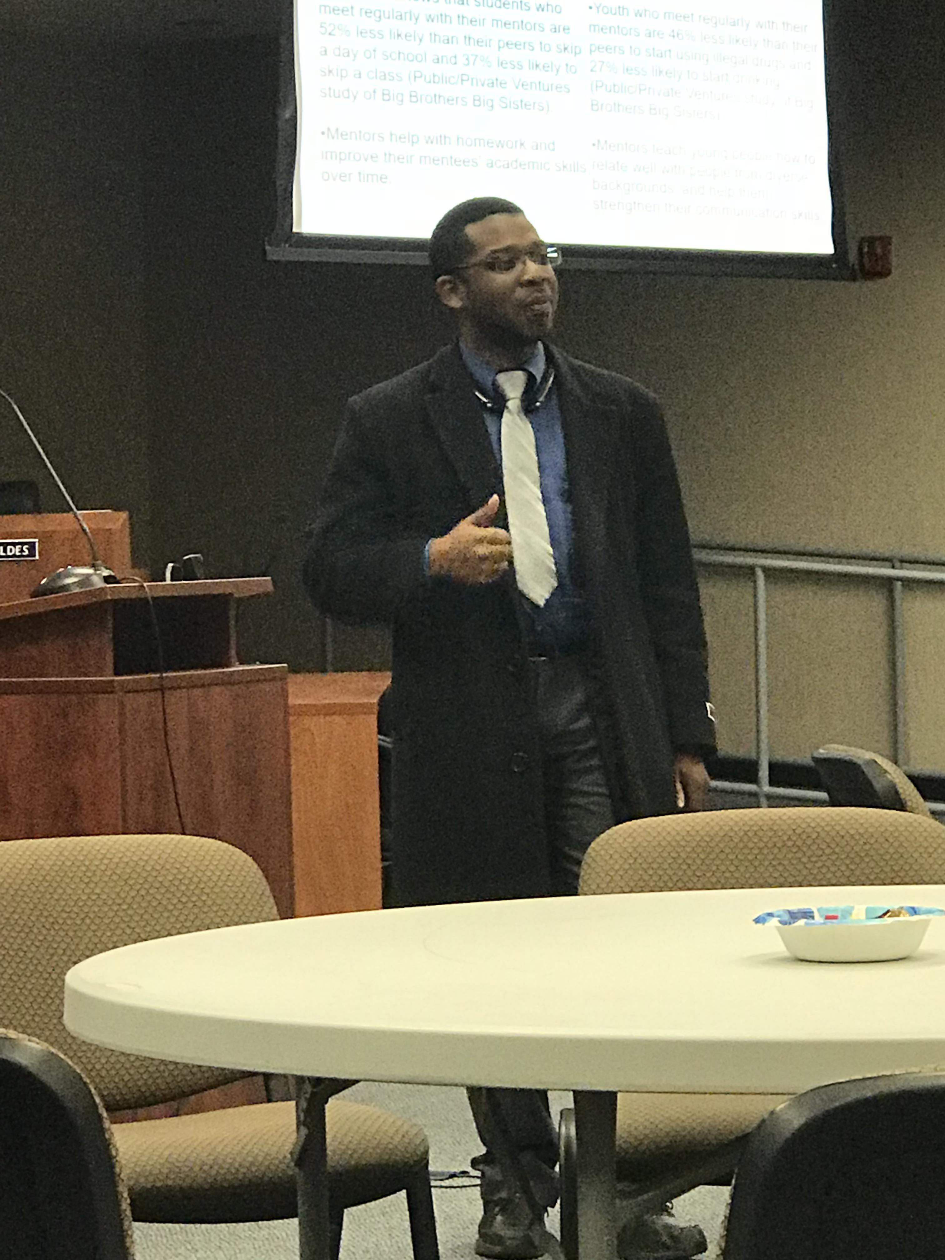 Corey Jackson speaking about Sigma Beta Xi.