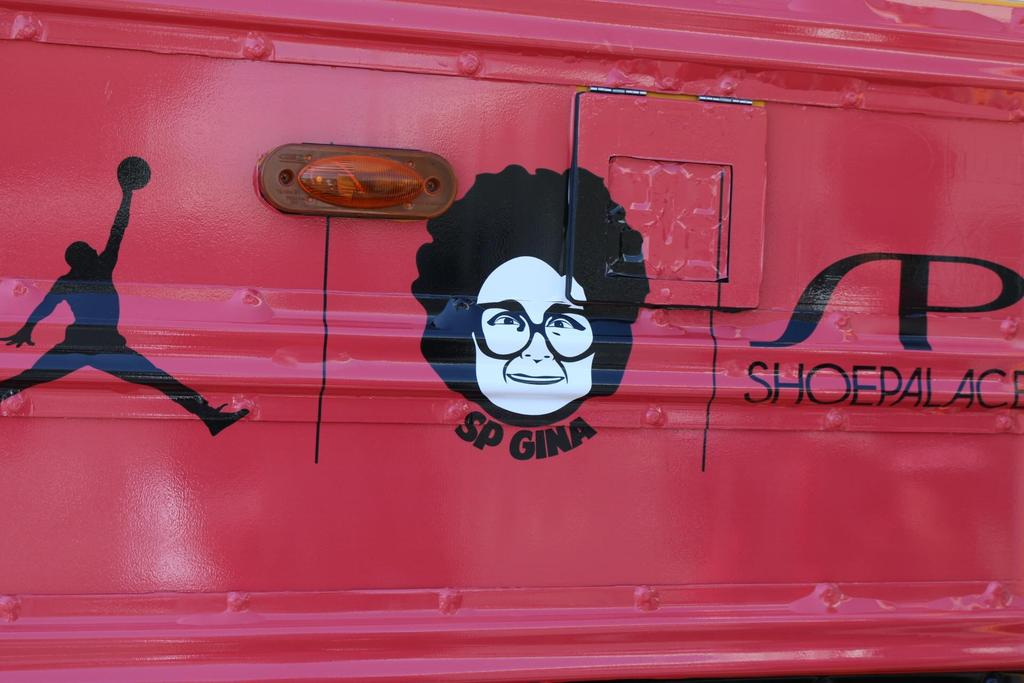 bus adorned with Air Jordan and SP Gina stickers