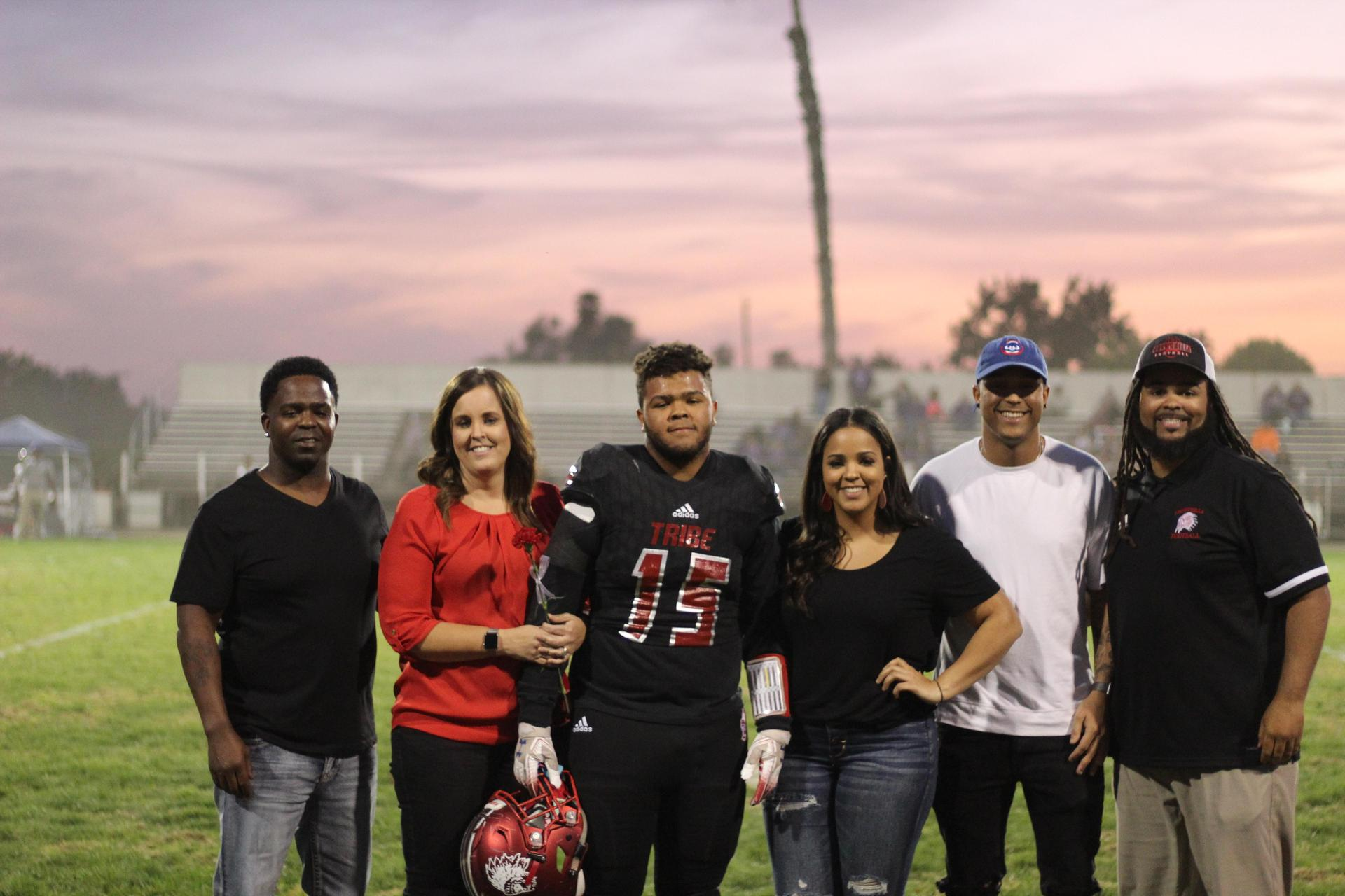 Senior football player Jaylinn Gaines and his escorts.