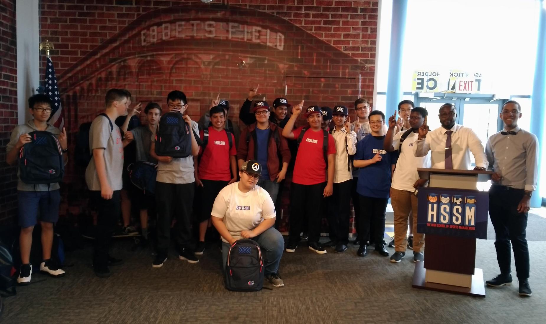 Students behind a HSSM podium