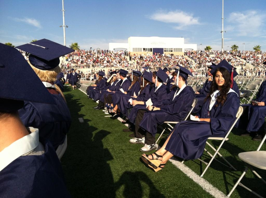 Students seated in the stadium for graduation