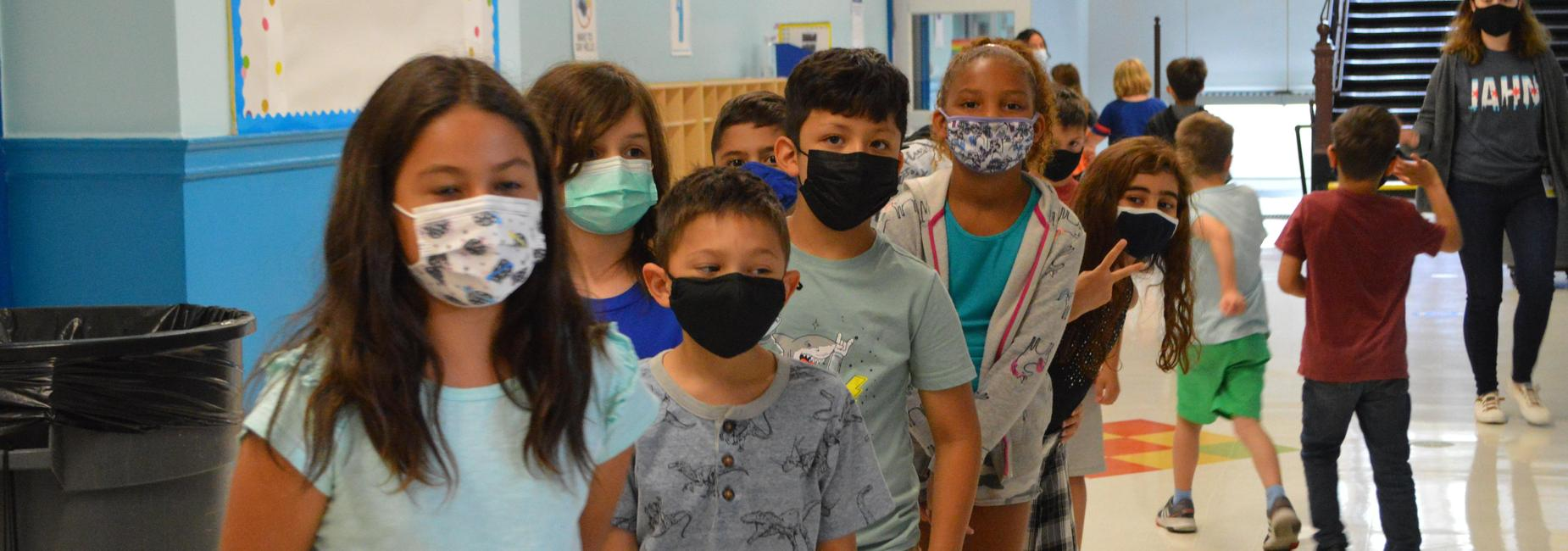 kids in line with masks