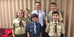 Scouts with Mr. Johnson at the scout luncheon