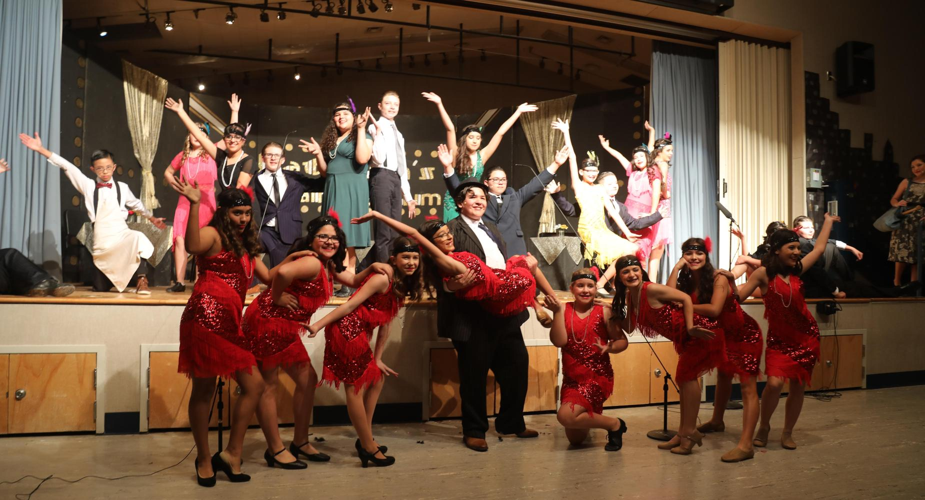 Bugsy Malone cast posing for play finale
