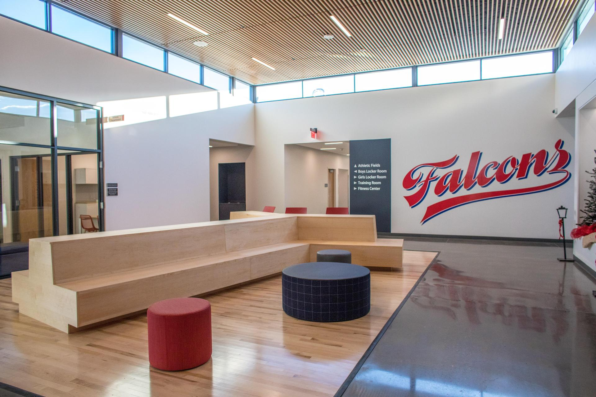 Saalfeld athletic center lobby with furniture and wall graphics