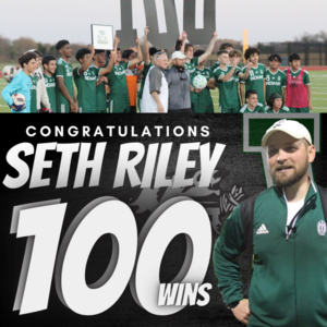 soccer team and coach holding numbers 100 marking 100th win for coach