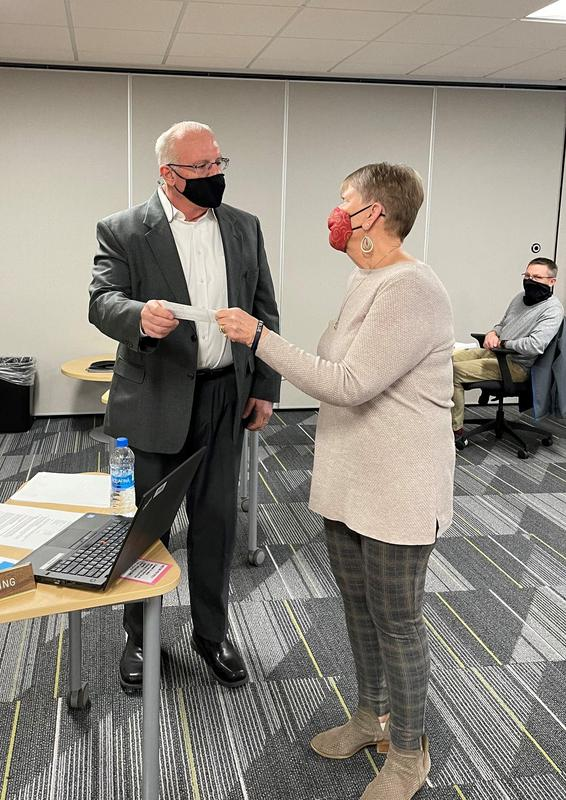 Foundation Treasurer Barb Schofield presents the donation check to Board of Ed President Bill Spaulding