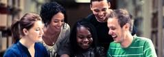 Web banner - a picture of a group of teachers collaborating