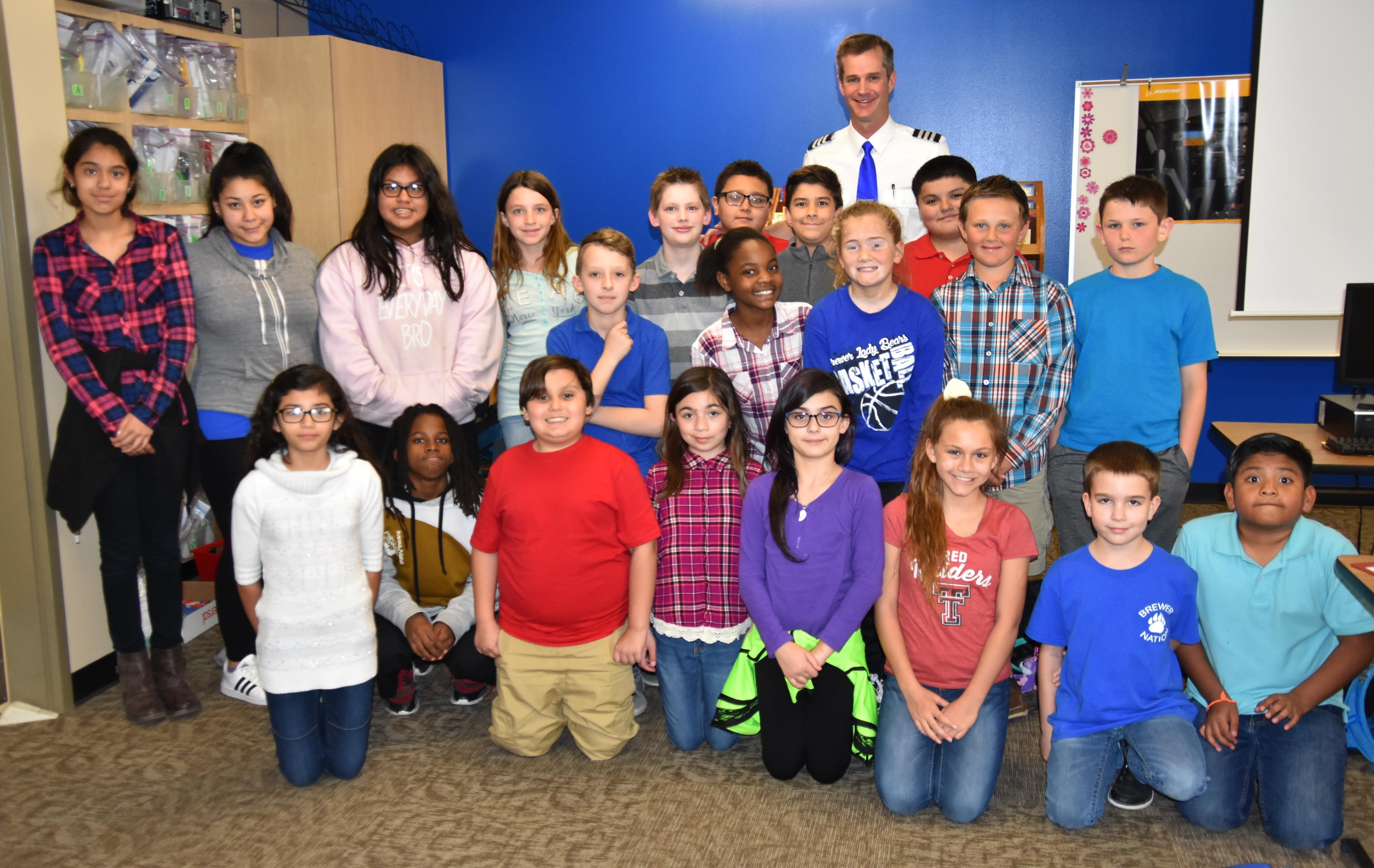 Fine Arts Academy fifth and sixth graders in the Career and Technical Education (CTE) class pose with Southwest Airlines pilot Scott Morrison.