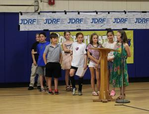 Photo of students saying words of praise for Jefferson fourth grade teacher Anna Carissimo is honored at the May 7 Board of Education meeting as the recipient of the 2019 Charles Philhower Fellowship Award which recognizes outstanding elementary school teachers.
