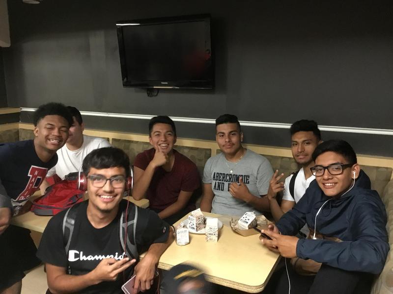 Guys hanging out at Godwin