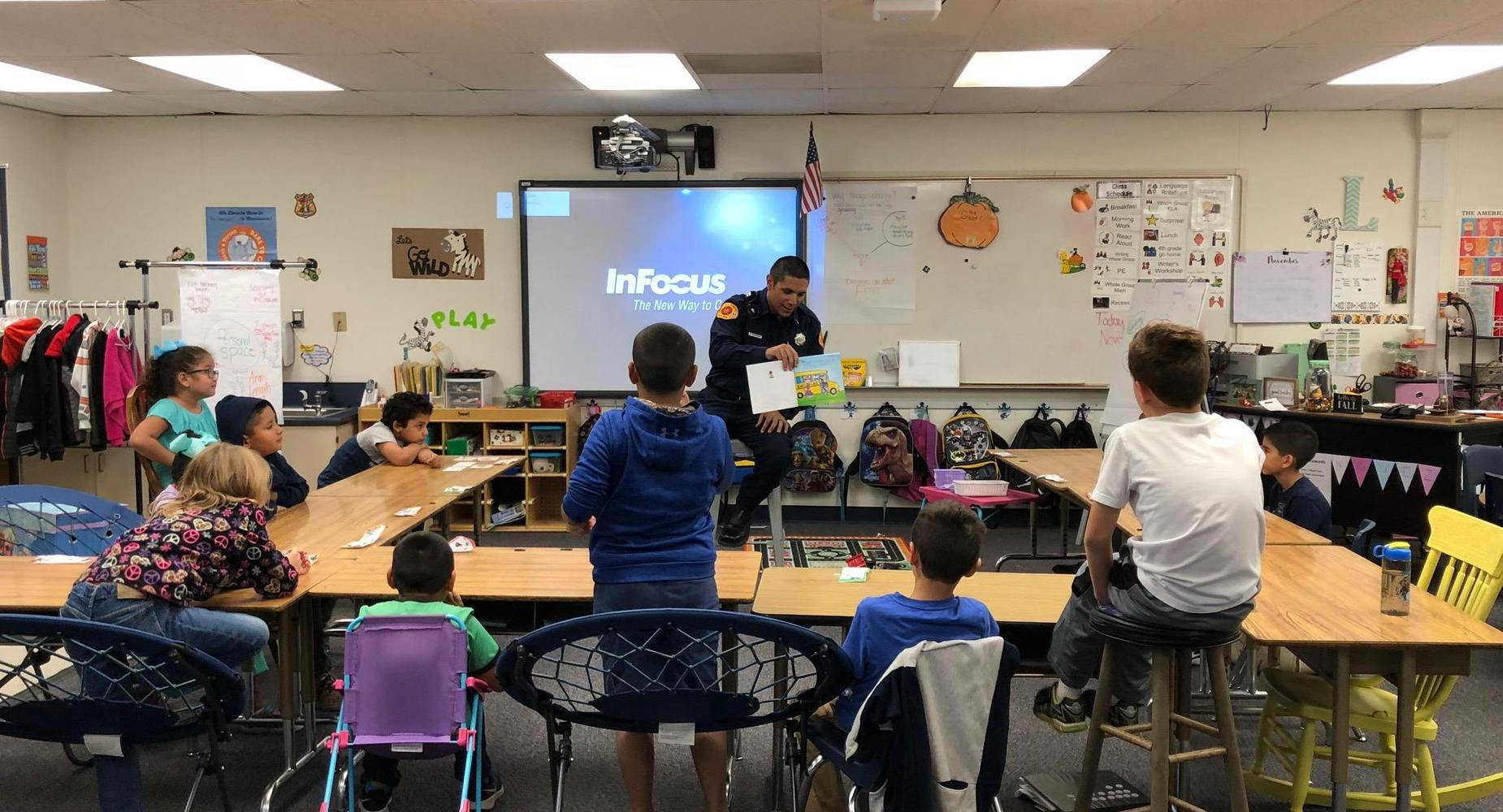 Firefighter reading to students
