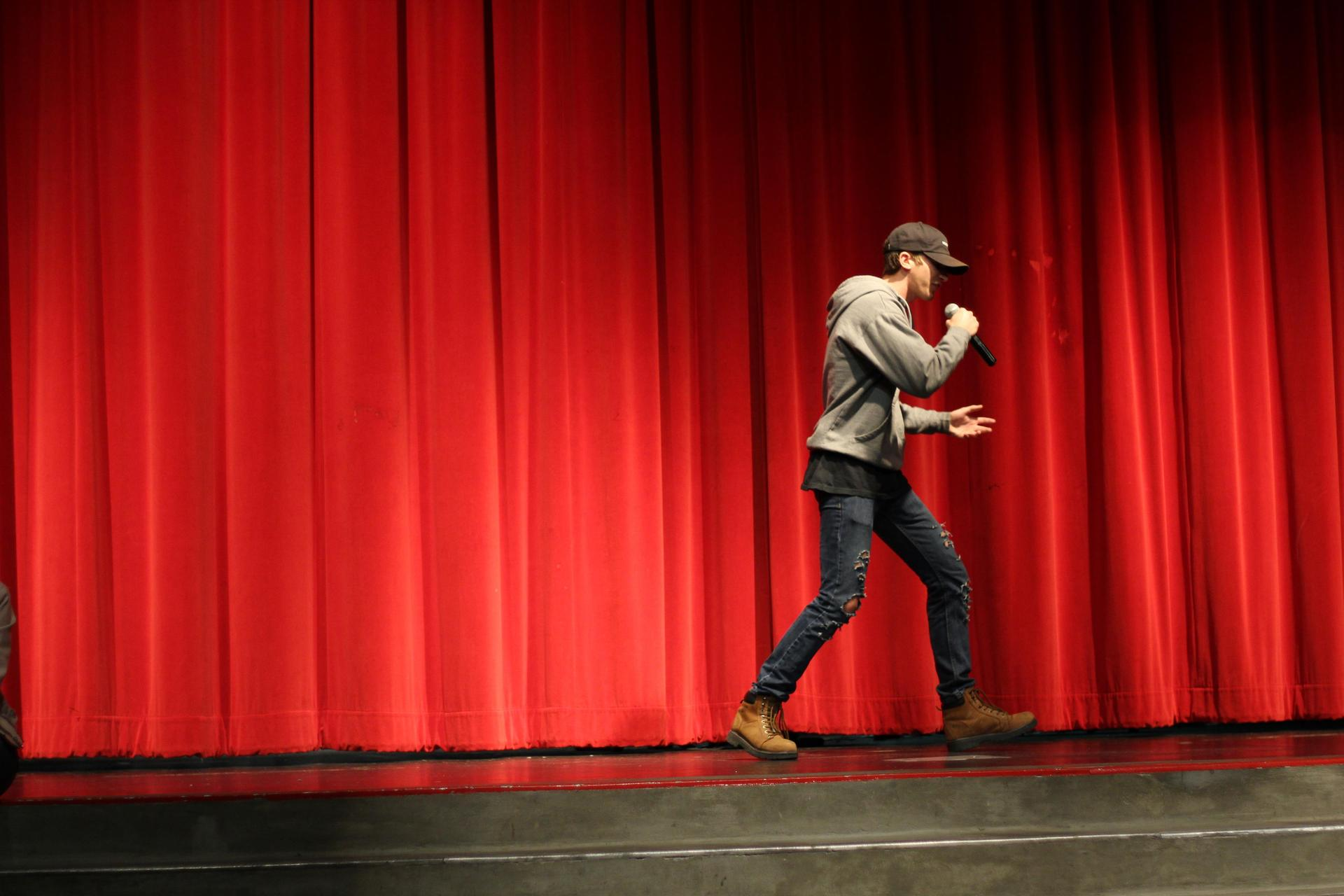 Michael Eggert performs his part of a duet with Sophia Atilano at the NSL Talent Show.